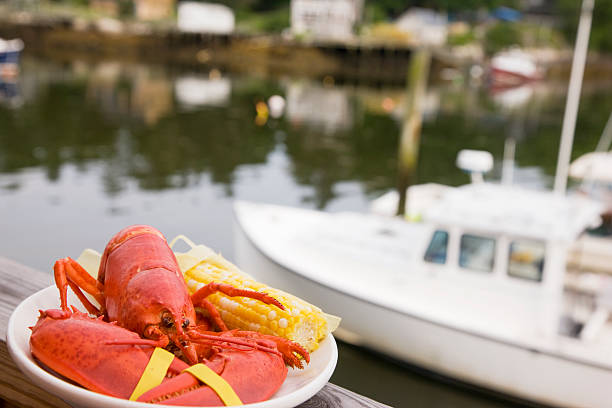 Lobster dinner at the dock. stock photo