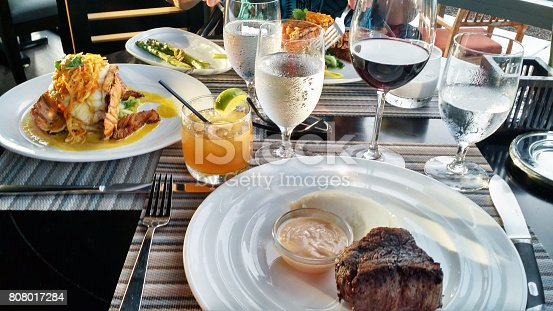 istock lobster, filet mignon and drinks 808017284