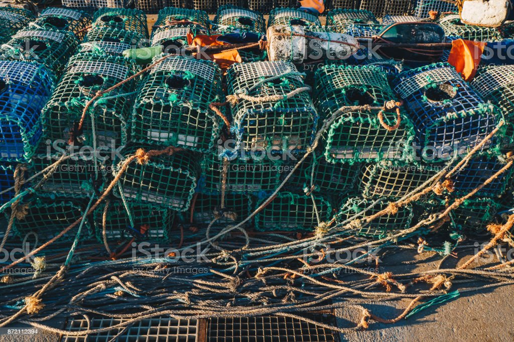 Lobster Fishing cages on the shore of a fishing harbour stock photo