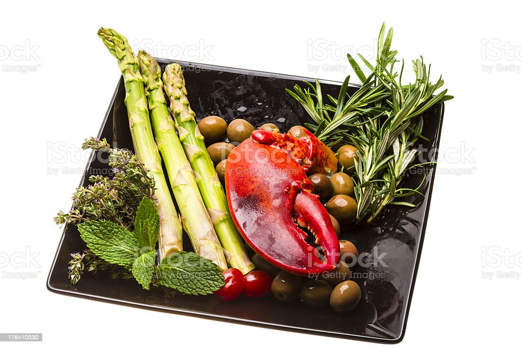 Lobster leg with salad and asparagus royalty-free stock photo