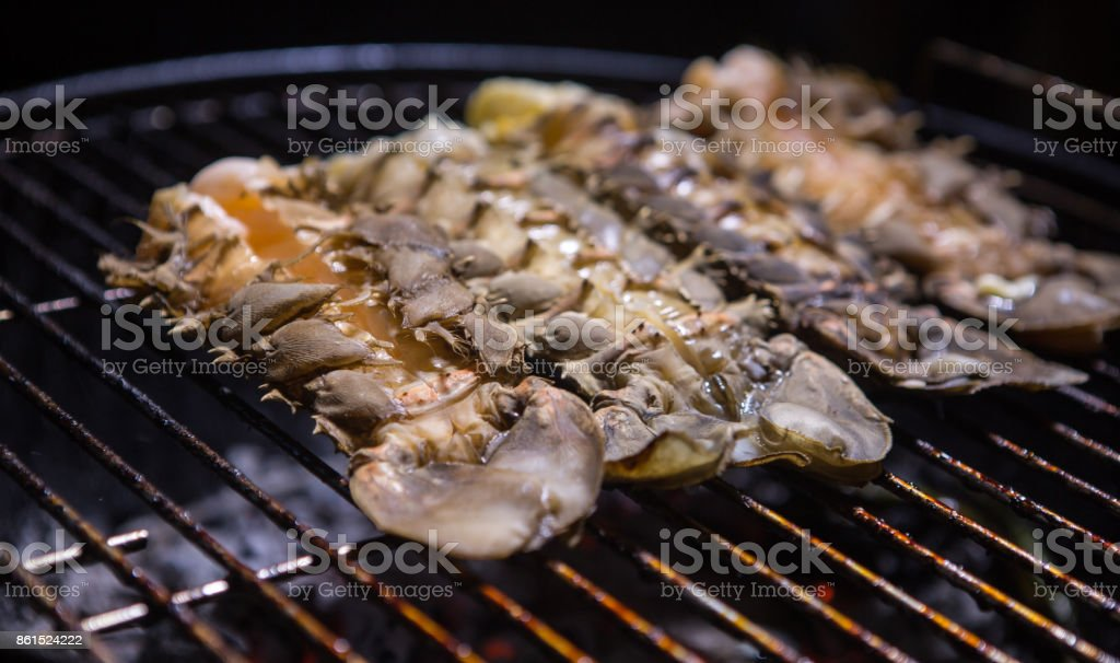 Lobster on the grill. Cooking lobster on bbq grill stock photo