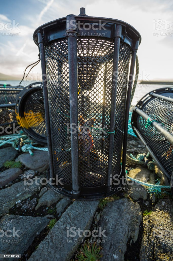 Lobster pot with bait inside at sunrise stock photo
