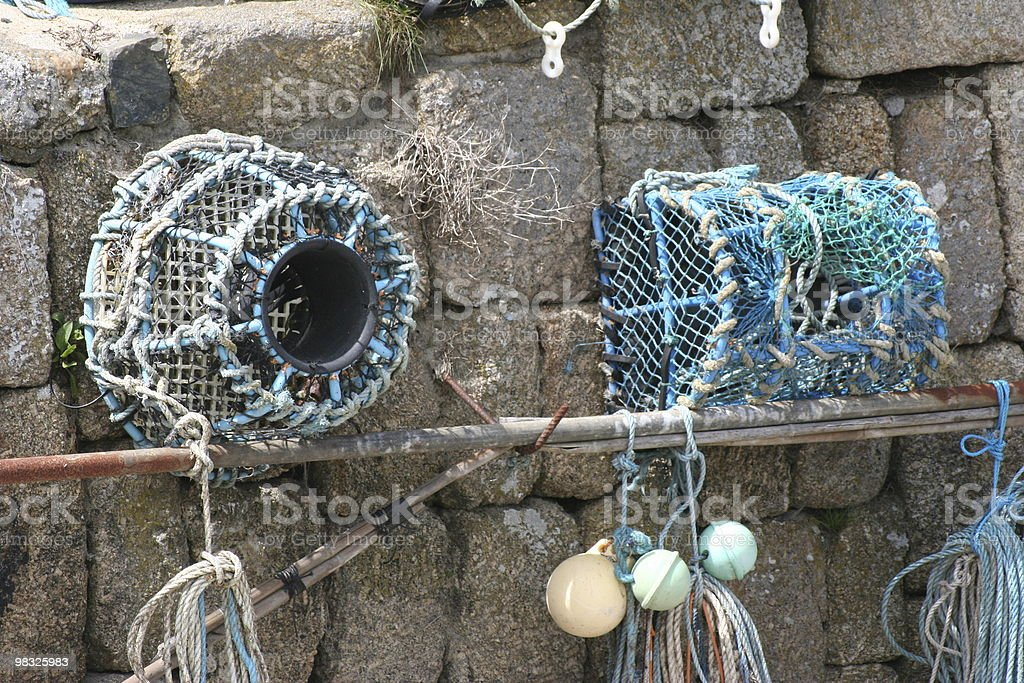 Lobster pots against harbour wall royalty-free stock photo