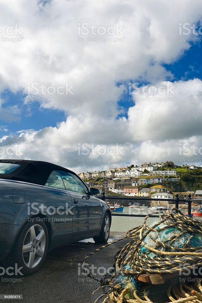 Lobster pots and luxury car royalty-free stock photo