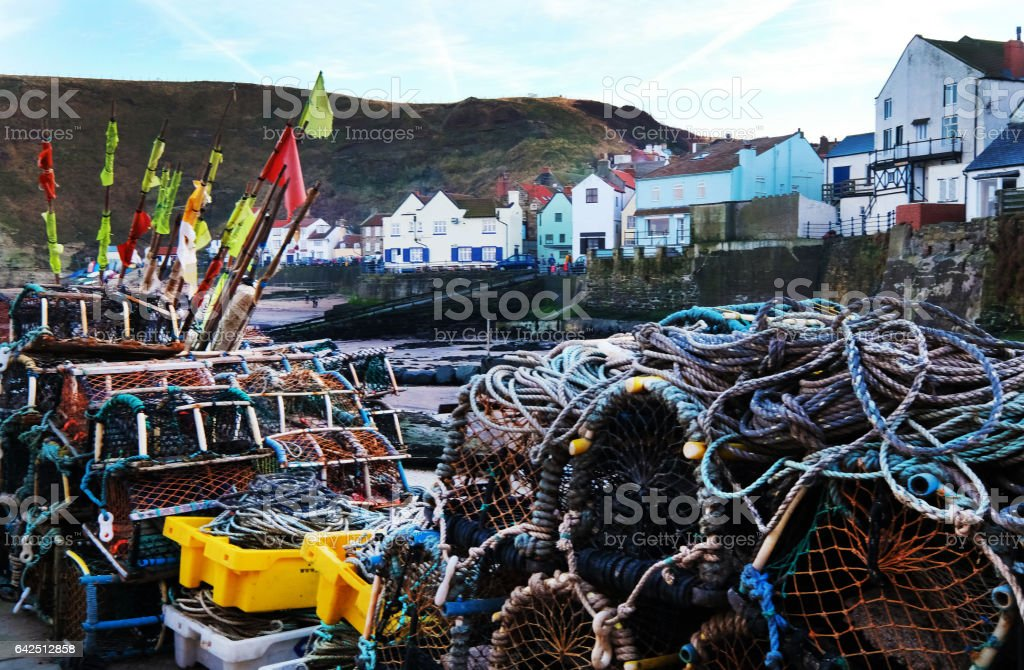 Lobster Pots and Staithes Village stock photo