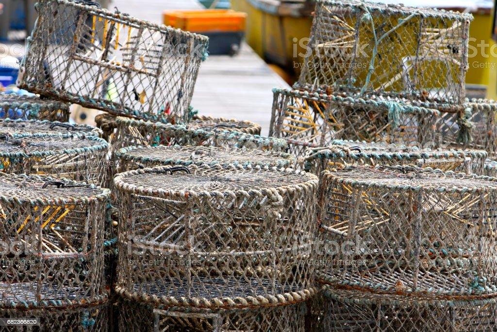 Lobster Pots on a wooden jetty royaltyfri bildbanksbilder