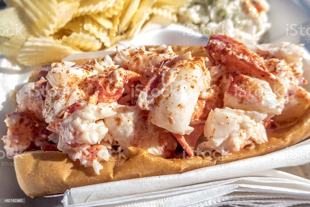Lobster Roll in Maine with Potato Chips and Coleslaw Close-up stock photo