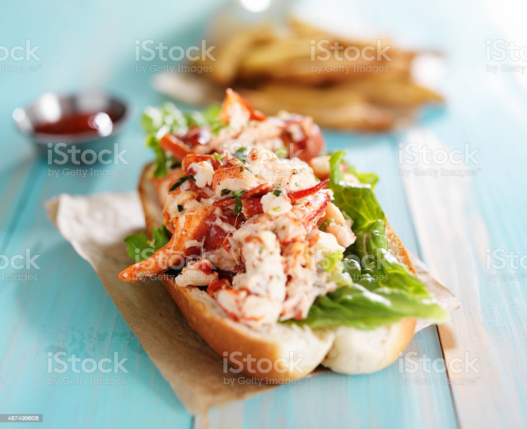 lobster roll on colorful retro painted wooden planks stock photo