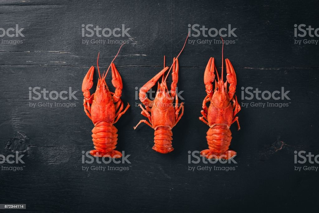Lobster. Seafood. On a wooden background. Top view. Free space for your text. stock photo