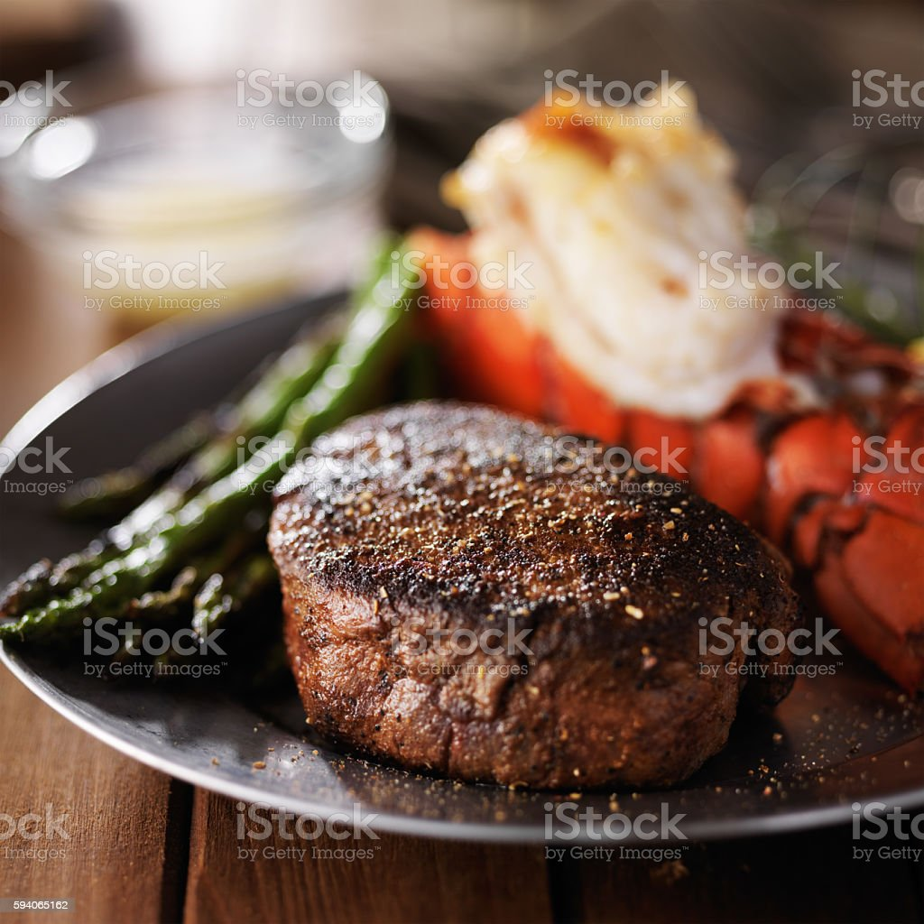 lobster tail and filet mignon dinner with asparagus stock photo