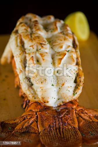 Lobster tail roasted in olive oil and topped with crushed almonds, garnished w/ scallions and Italian parsley & served with garlic Brussel sprouts. Classic Italian, American restaurant or French bistro entree.