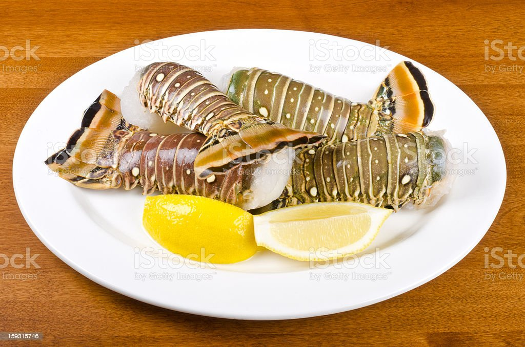 Lobster Tails and Lemon Wedges royalty-free stock photo