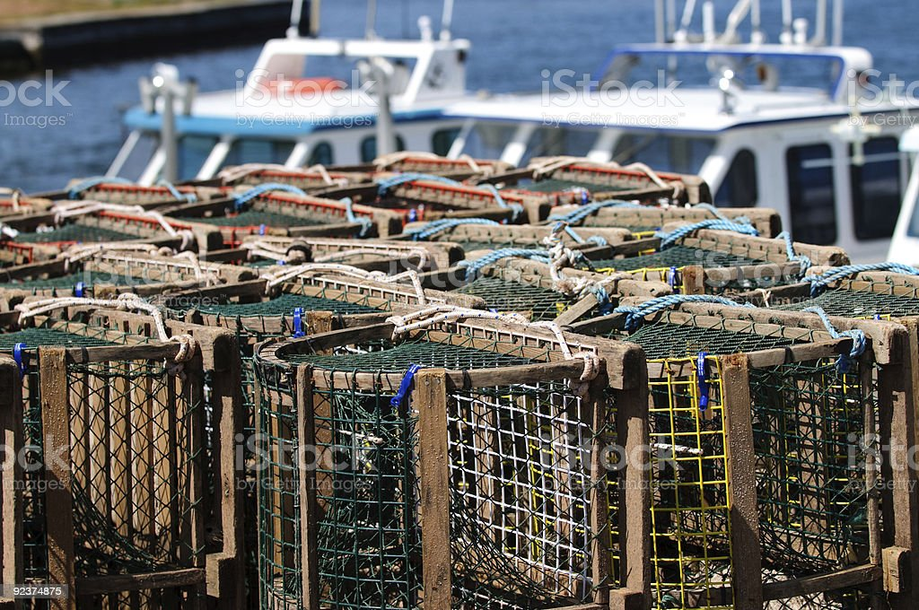 Lobster traps and boats royalty-free stock photo