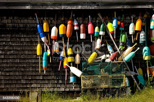 Lobster traps and buoys at boathouse