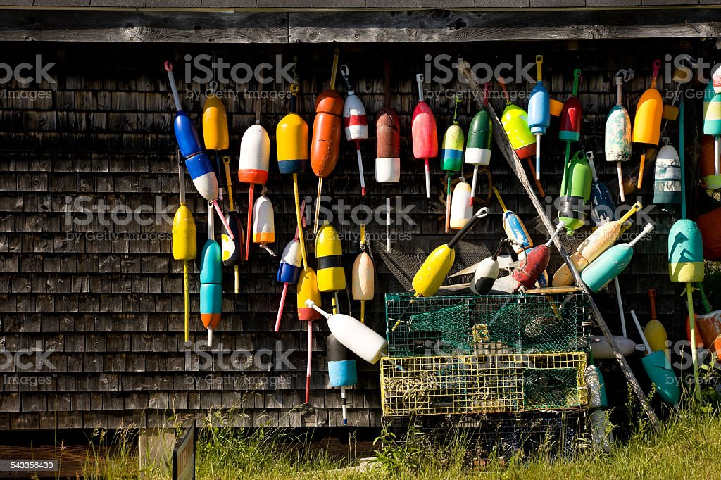 Lobster traps and buoys at fisherman's hut stock photo