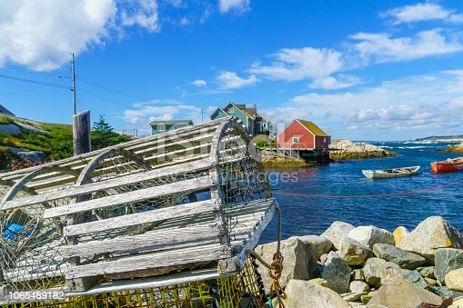View of lobster traps, boats and houses, in the fishing village Peggys Cove, Nova Scotia, Canada
