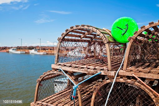 Lobster traps piled up on the wharf at West Point, Prince Edward Island, Canada