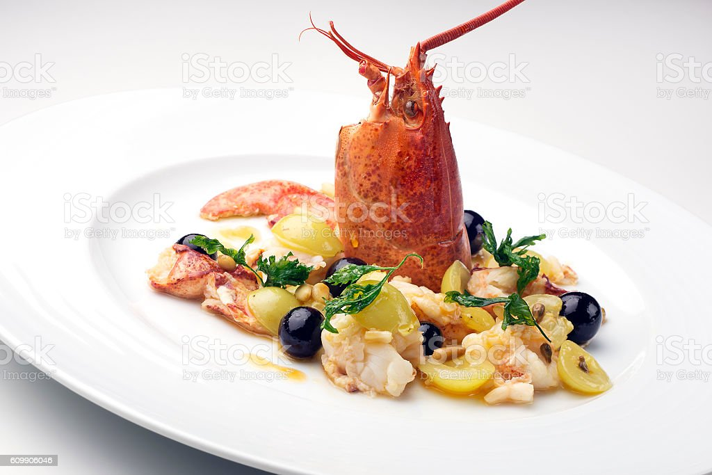 Lobster with raisins and pine nuts stock photo