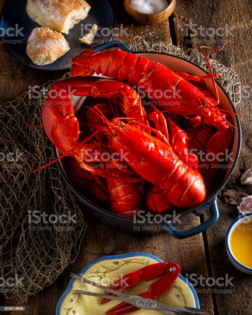Lobsters in a Pot on a Rustic Wooden Tabletop stock photo