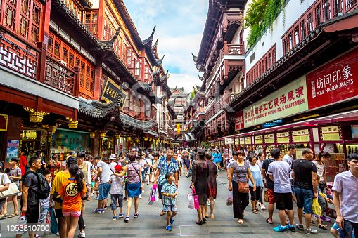 Shanghai, China - July 21st. 2016 - Local and tourists enjoying a hot summer day in downtown Shanghai in China, Asia.