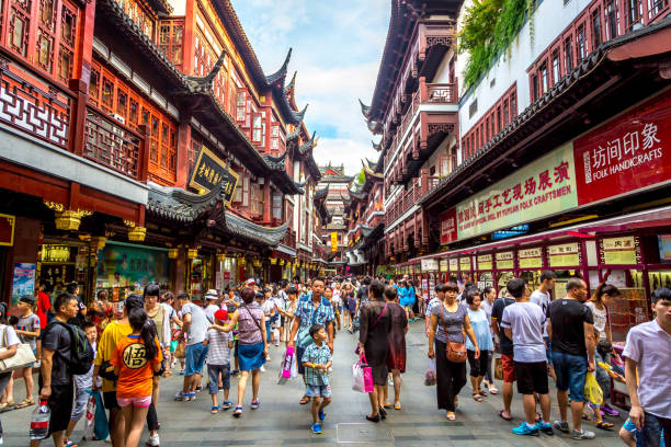 Local and tourists enjoying China Shanghai, China - July 21st. 2016 - Local and tourists enjoying a hot summer day in downtown Shanghai in China, Asia. shanghai stock pictures, royalty-free photos & images