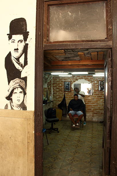 Local barber with customer in Cuba stock photo