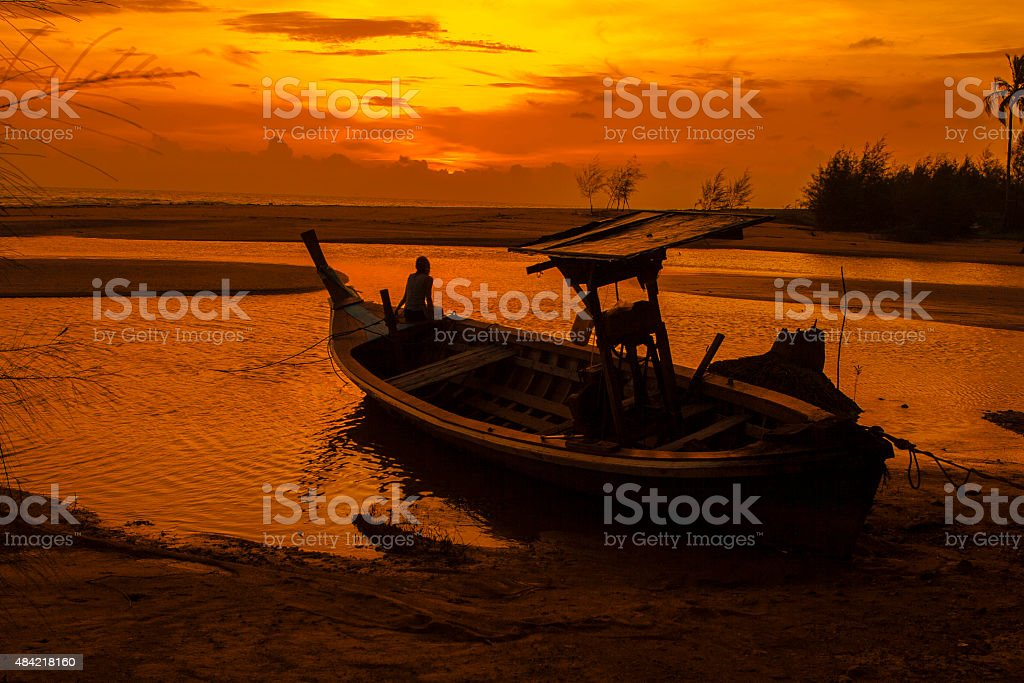 Local Boat On The Beach At Sunset Time stock photo