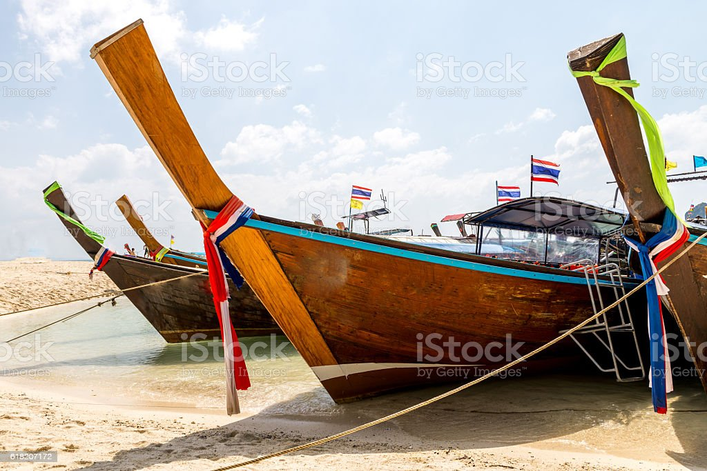 Local Boat Sea Sand Beach in Krabi, Thailand Jan 2016 stock photo