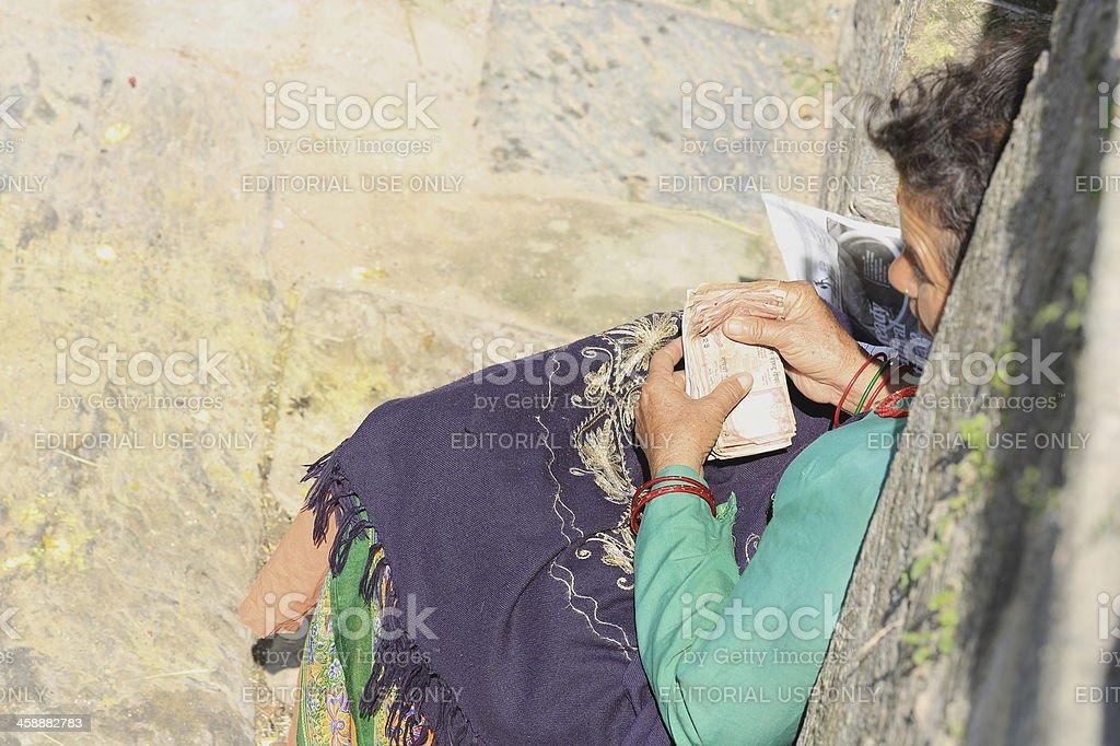 Local business woman in Pashupatinath temple-Deopatan-Kathmandu-Nepal. 0294 stock photo