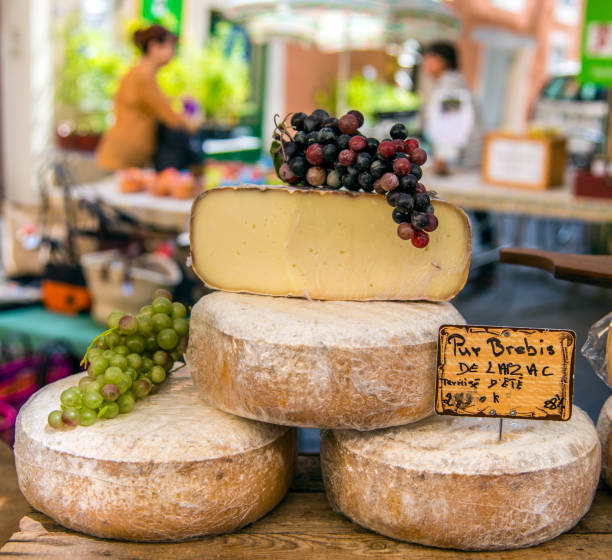 Local cheeses on sale at the market, Saint-Remy-de-Provence, Provence, France stock photo