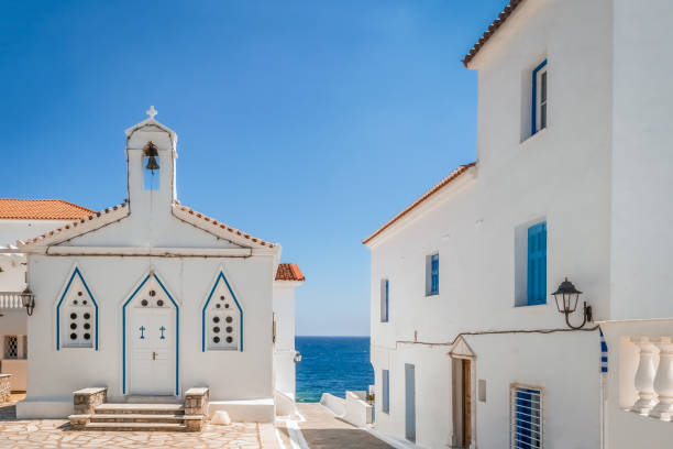 Local church at Chora in Andros island in Greece. Beautiful Cyclades. stock photo