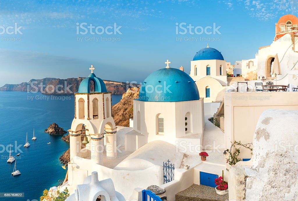 Local church with blue cupola in Oia, Santorini, Greece stock photo