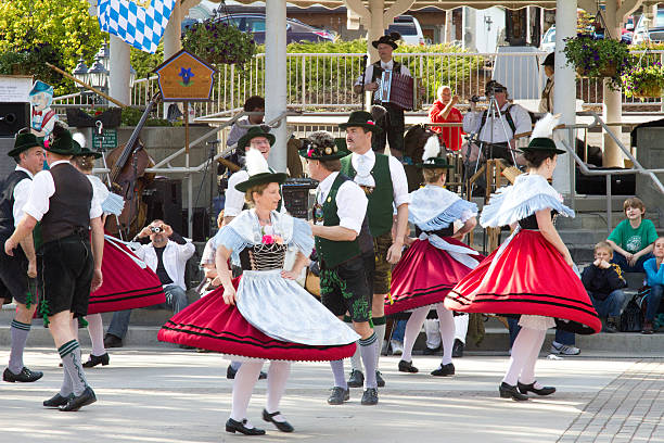 local citizens performing dance wearing traditional bavarian attire - leavenworth washington stock photos and pictures
