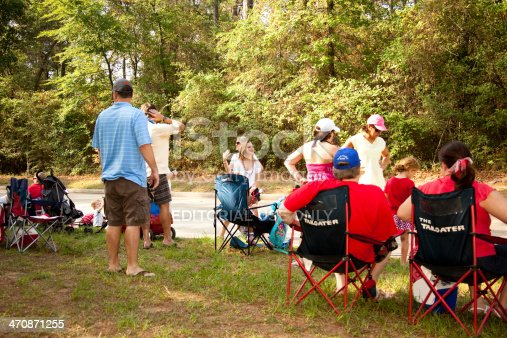 istock Local community of spectators wait for July 4th parade. 470871255