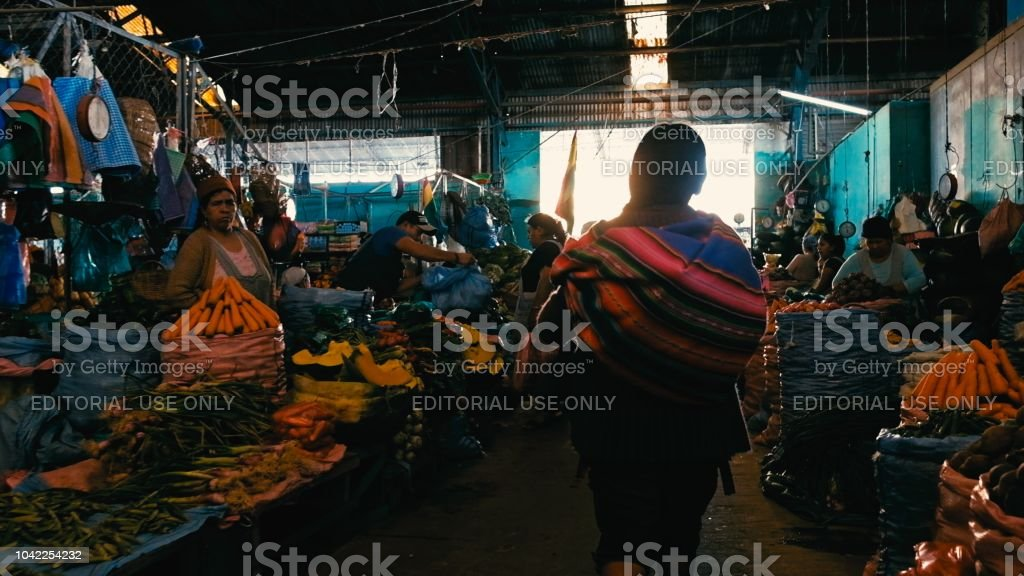local farmers selling their produce the city market with a local...