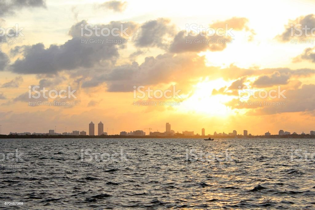 Local Fisherman Going Home in Sunset stock photo