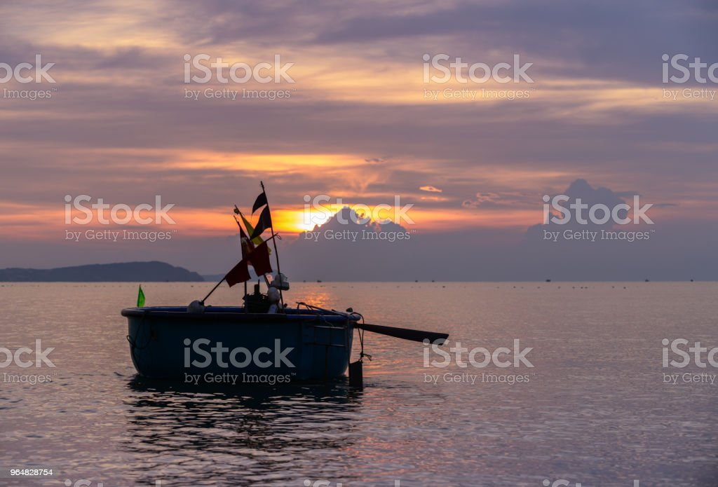 Local fishing boats in the sea with beautiful sky royalty-free stock photo