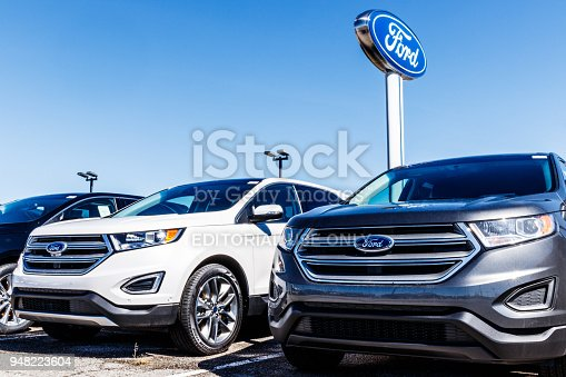 istock Local Ford Car and Truck Dealership. Ford sells products under the Lincoln and Motorcraft brands VI 948223604