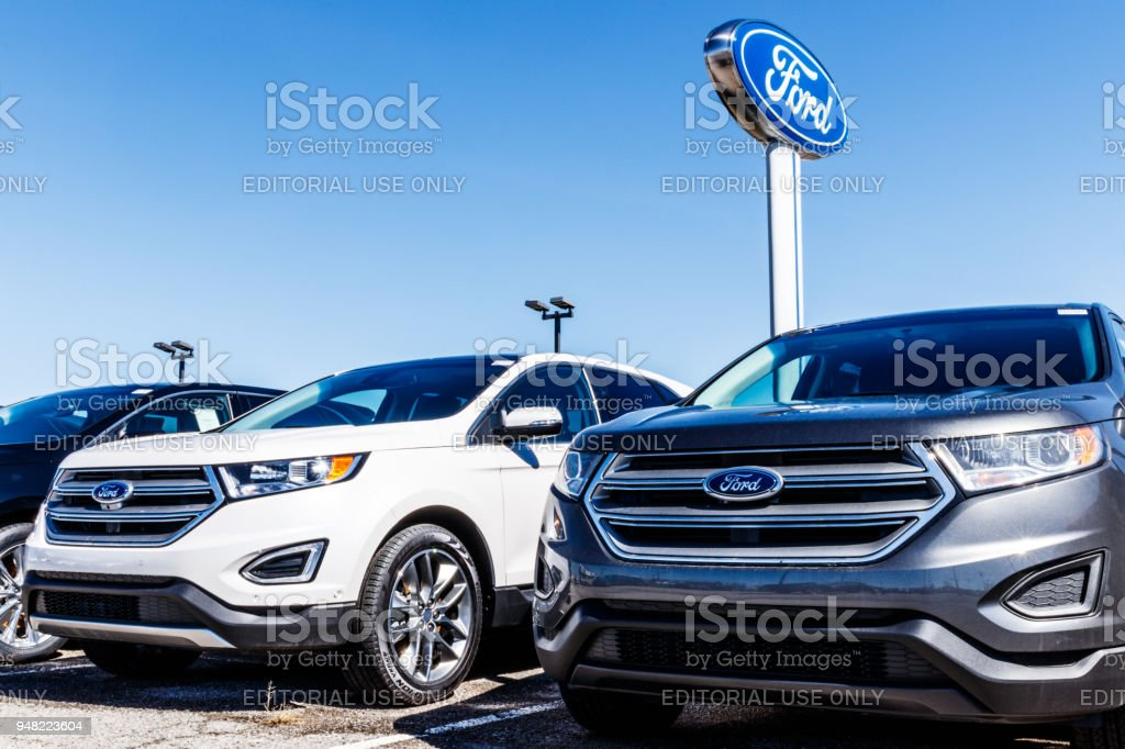 Local Ford Car and Truck Dealership. Ford sells products under the Lincoln and Motorcraft brands VI stock photo