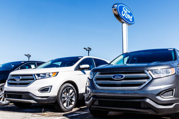 Local Ford Car and Truck Dealership. Ford sells products under the Lincoln and Motorcraft brands VI Fishers - Circa March 2018: Local Ford Car and Truck Dealership. Ford sells products under the Lincoln and Motorcraft brands VI vehicle brand name stock pictures, royalty-free photos & images