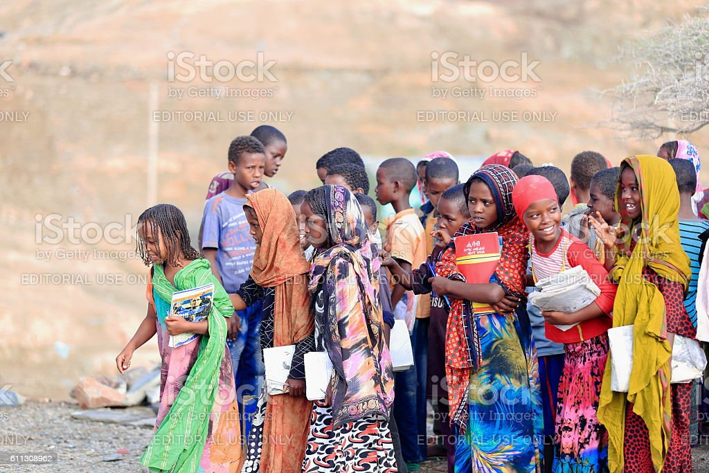 Local girls-boys to enter their school classrooms. Berahile-Ethiopia. 0396 stock photo