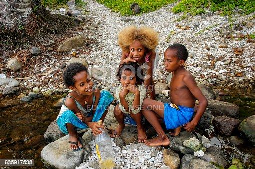 Taveuni, Fiji - November 25, 2013: Local kids playing by the river along Lavena Coastal Walk, Taveuni Island, Fiji. Taveuni is the third largest island in Fiji.