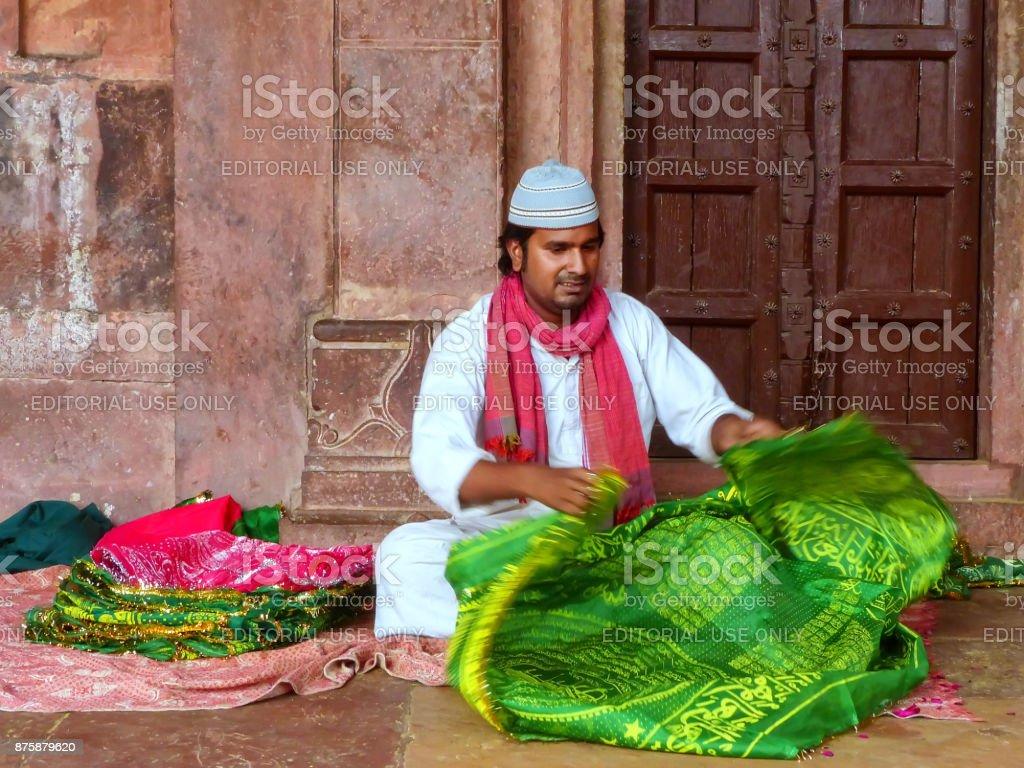 Local man folding cloth inside Jama Masjid in Fatehpur Sikri stock photo