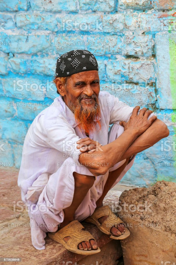 Local man sitting by the house in Fatehpur Sikri, India stock photo