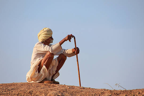 Local man sitting on a hill, Khichan village, India stock photo