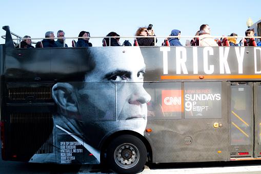 Washington, DC, USA – April 1, 2019: Local metro bus with advertisement for Richard Nixon TV program