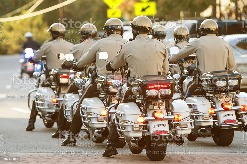 Local Motorcycle Cops Ride Through Town At Georgia Festival stock photo