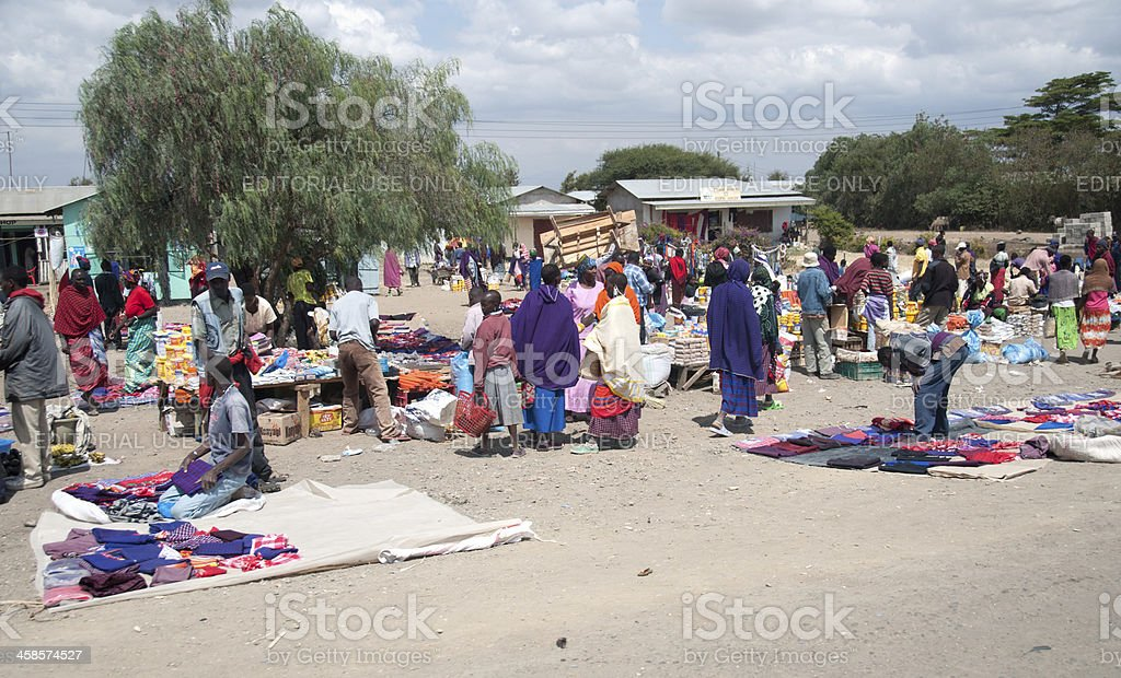 A local outdoor market selling all kinds of goods from clothing, food...