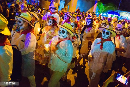 Day of the Dead or Dia de los Muertos. A Muti-days Mexican holiday festival start on October 3. The celebration and remembrance of family and friends who have died. Local residents dressing up with painted faces parade and celebrate for several days in the Plaza and grave sites.