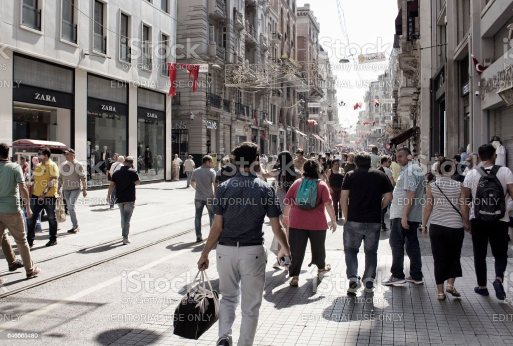 Local people and tourists walk on Istiklal Avenue